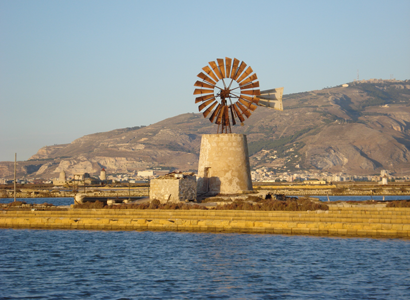 Windmill used for draining water from the salt flat basins, Trapani, Sicily - Louise M Harrington